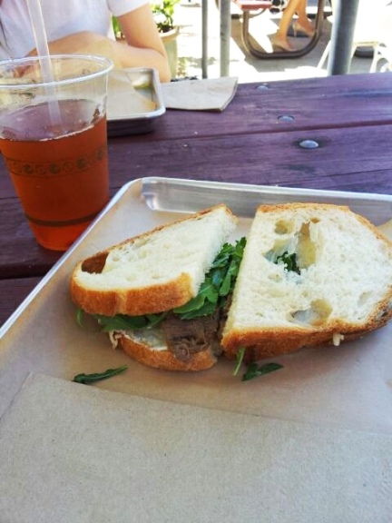 Niman Ranch Braised Beef sandwich with house-made iced tea